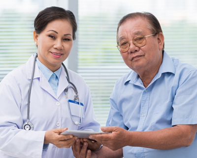 a doctor showing the analysis results to the patient